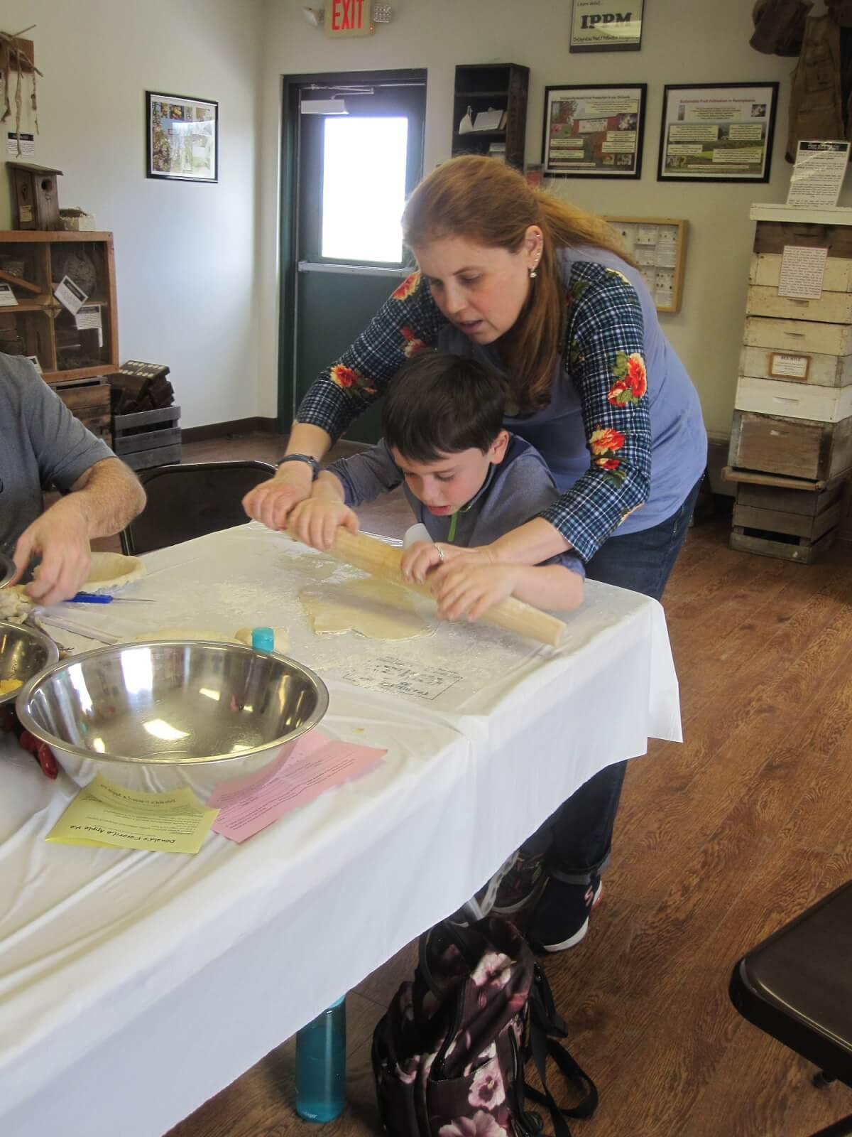 Family making pie crust
