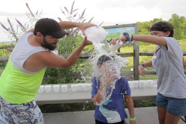 child getting water dumped on his head