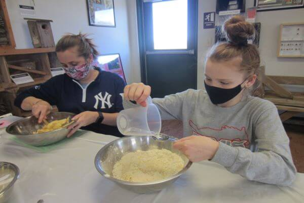 teen mixing flour to make muffins