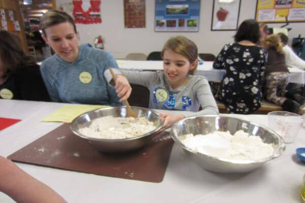 mother and daughter mixing dry ingredients
