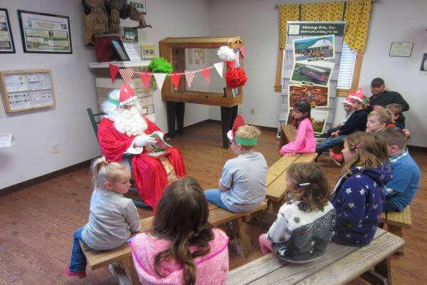 santa reading a story to children